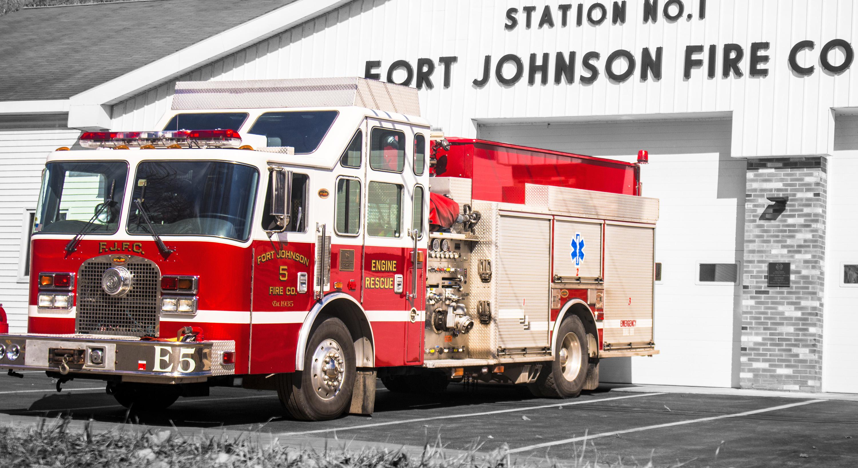 A photo of Engine 5, a fire truck, with selective color showing a back background.