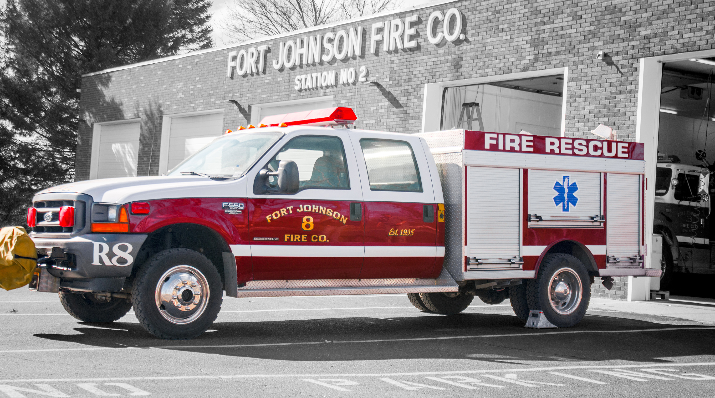 A photo of Rescue 8, in the style of a pickup truck, with selective color showing a back background.