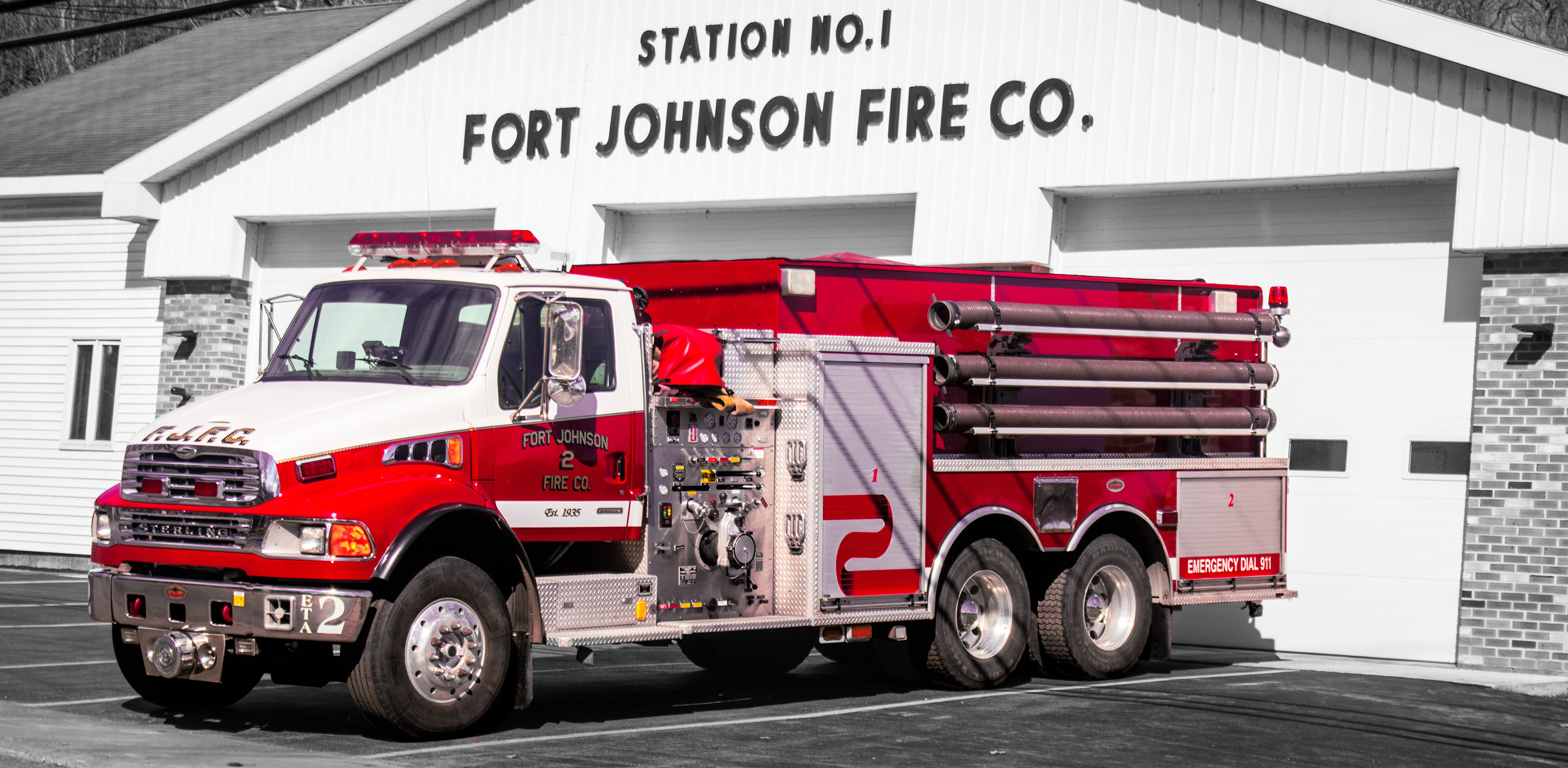 A photo of Tanker 2, a fire truck, with selective color showing a back background.
